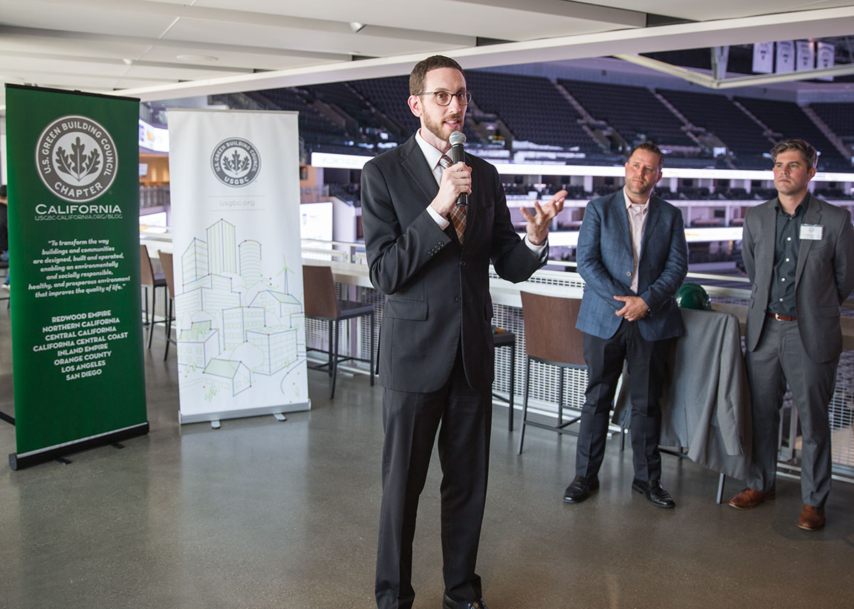 Senator Wiener addresses USGBC members at LEED Platinum, net zero energy Golden1 Center while USGBC's Brenden McEneaney and Wes Sullens look on.